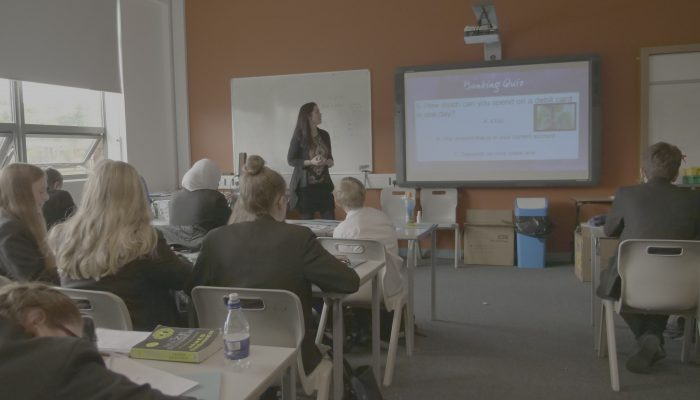 Young People Listen To Financial Education Workshop